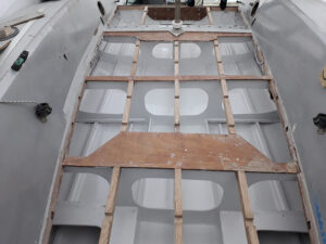 Preparation of cockpit deck frame for reinforcement and bilges repainting